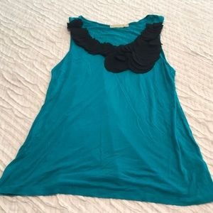 Turquoise tank with black floral embellishment